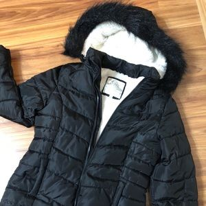 Black children's winter coat from Justice.